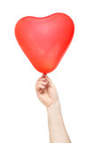 Hand hold  balloon in the shape of heart Stock Images