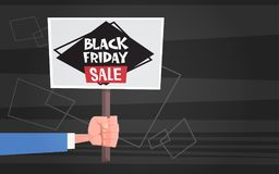 Hand Hold Banner With Black Friday Sale Text Special Offer Discount Poster Background With Copy Space Concept Royalty Free Stock Images