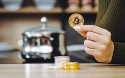 Hand hold bitcoin coin stock photo