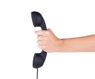 Hand hold black phone tube Stock Image