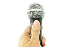 Hand hold black and silver microphone for interview isolated Stock Photo