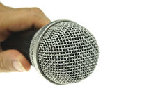 Hand hold black and silver microphone isolated Royalty Free Stock Photo