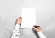Hand hold blank contract mockup and signing it Stock Images