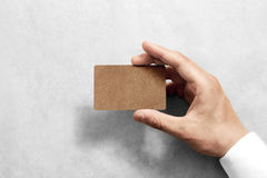 Hand hold blank craft card mockup with rounded corners. Royalty Free Stock Photography