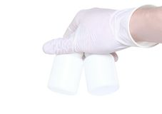 Hand hold a blank medical bottle. Isolated Stock Photo