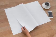Hand hold Blank Newspaper with empty space mock up on wood background stock photos