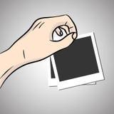 Hand hold blank photos. Stock Photo