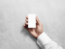Hand hold blank vertical white business card design mockup. Stock Photos