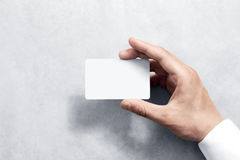 Hand hold blank white card mockup with rounded corners. Plain call-card mock up template holding arm. Plastic credit namecard display front. Check offset card Royalty Free Stock Photography