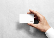 Hand hold blank white loyalty card mockup with rounded corners. Plain vip mock up template holding arm. Plastic discount namecard display front. Gift offset royalty free stock photos