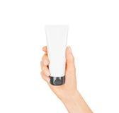 Hand hold blank white tube mock up . Empty cream bottle royalty free stock photos