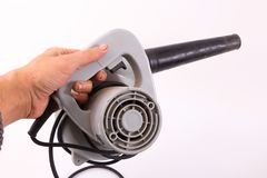 Hand hold blower. On white background Royalty Free Stock Photos