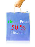 Hand hold blue paper shopping bag on reflect white Stock Photos