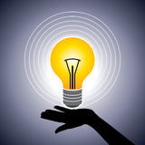 Hand hold bright light bulb Stock Image