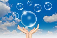 Hand hold Bubbles in the sky Stock Photo