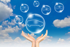 Hand hold Bubbles in the sky with car inside Royalty Free Stock Image