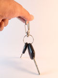 Hand hold Car Key and Remote control on white background Royalty Free Stock Photo