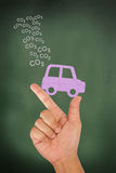 Hand hold car release carbondioxide emission Stock Photos