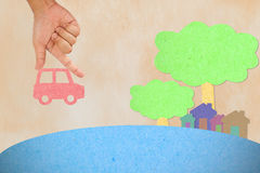 Hand hold car to village Royalty Free Stock Photos