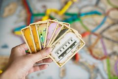 Hand hold cards of Ticket to ride game. stock photo