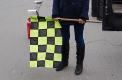 Hand hold checkered rally racing start flag Royalty Free Stock Photography