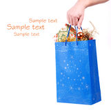 Hand hold christmas bag with presents Royalty Free Stock Photos