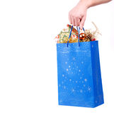 Hand hold christmas bag with presents Stock Images