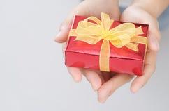 The hand hold christmas present Stock Photos