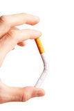The hand hold a cigarette. Harm of smoking Royalty Free Stock Photography