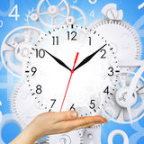 Hand hold clock with figures and gears Stock Photos