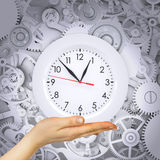 Hand hold clock with gears Royalty Free Stock Photography