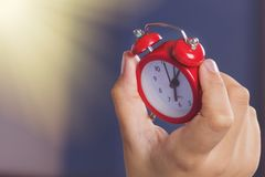 Hand hold clock, someone look time on clock. Stock Images