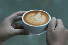Hand hold coffee cup