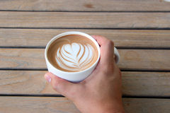 Hand hold coffee cup Royalty Free Stock Images