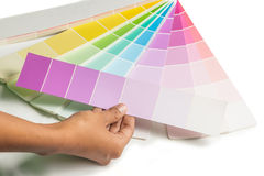 A hand hold colored swatches for choose paint samp Royalty Free Stock Photo