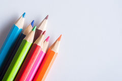 Hand hold colorful pencils on white background Royalty Free Stock Photo