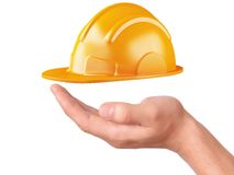 Hand hold Construction Helmet on white background Stock Photos