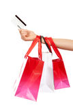 Hand hold credit gift card and shopping. Bags isolated on a white background Stock Image