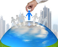 Hand hold 3D people on nature globe. With city background Royalty Free Stock Photo