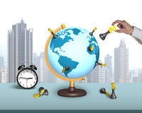 Hand hold dollar chess on terrestrial globe with alarm clock. And city skyscraper background royalty free stock photo