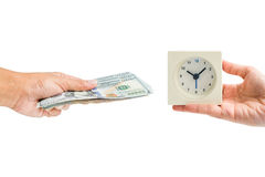 Hand hold dollar money cash exchange with hand hold time clock. Isolated hand hold dollar money cash exchange with hand hold white square alarm clock - business Royalty Free Stock Photos