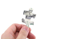 Hand hold dollar puzzle. Hand hold us dollar puzzle stock images