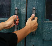 Hand hold door handle Royalty Free Stock Images