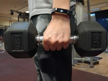 Hand hold dumbbell stock images