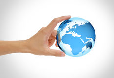 Hand hold earth. Hand holding the earth isolated on white background, green globe concept Royalty Free Stock Photos