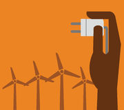 Hand hold eco power plug and Wind turbines Stock Photos