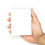 Hand hold a empty(blank) note book on white Royalty Free Stock Photo