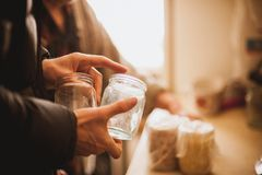 Hand hold empty glass jar Stock Photos