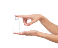 Hand hold empty glass or plastic shower gel cream bottle contain Royalty Free Stock Photography