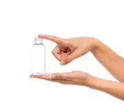 Hand hold empty glass or plastic shower gel cream bottle contain Royalty Free Stock Photo